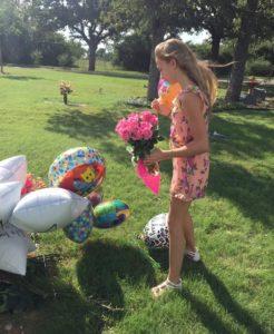 Janae visiting Tita's grave